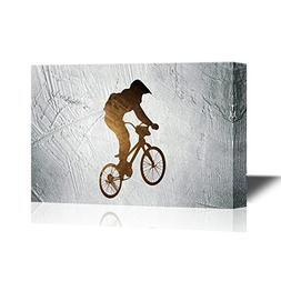 wall26 - Canvas Wall Art - Silhouette of a Man Doing a Bike
