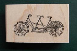 P24 Miniature tandem bicycle rubber stamp WM 0.4x0.9""